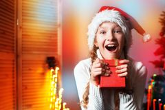 Smiling girl near christmas tree at home Stock Photo