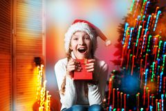 Smiling girl near christmas tree at home royalty free stock photos