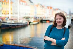 Smiling girl in Nyhavn, Copenhagen Royalty Free Stock Image
