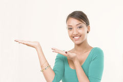 Smiling girl offers copy space Royalty Free Stock Photos