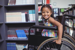 Smiling Girl On Wheelchair At Library Stock Photos