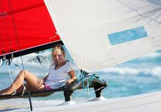 Smiling girl onbard sea yacht Royalty Free Stock Photography