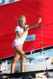 Smiling girl onboard sea yacht Stock Photography