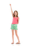 Smiling girl with one arm raised Royalty Free Stock Photos