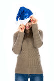 Smiling girl with one eye peeking out of Santa hats.  Royalty Free Stock Image