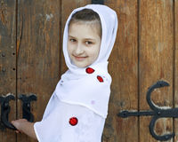 A Smiling Girl Opening the Door Stock Image