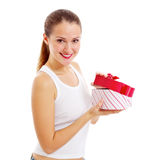 Smiling girl opens gift Royalty Free Stock Photo