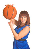 Smiling girl with orange basket ball Royalty Free Stock Images