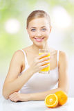 Smiling girl with orange juice Royalty Free Stock Photo