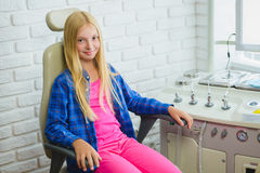 Smiling girl in Otolaryngologist cabinet at clinic Royalty Free Stock Photography