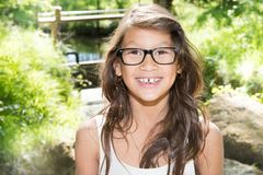 Smiling girl outdoor portrait with glasses. Beautiful smiling girl outdoor portrait with glasses Stock Image