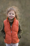 Smiling girl outdoors in vest Stock Photography