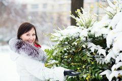 Smiling girl outdoors on a winter day Royalty Free Stock Images
