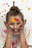 Smiling girl with paint on her face Royalty Free Stock Image