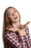 Smiling girl with painted face and hands in colorful paints Royalty Free Stock Photo
