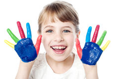 Smiling girl with painted hands Stock Photo