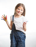 Smiling girl with painted hands and face over white background Royalty Free Stock Image