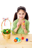 Smiling girl painting easter eggs Royalty Free Stock Image