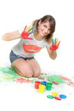 Smiling girl painting over white. Young smiling girl painting over white Royalty Free Stock Images