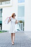 Smiling girl with paper bags Royalty Free Stock Image