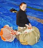 The smiling girl-parachutist Royalty Free Stock Photos