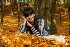 Smiling girl in the park Royalty Free Stock Photography
