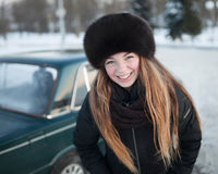 A smiling girl in a park in winter Stock Image