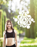 Smiling girl in park with yoga sketches Stock Image