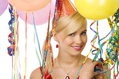 Smiling girl in party with balloons Royalty Free Stock Photo