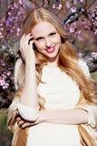 Smiling girl in peach garden Stock Photo