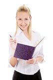Smiling girl with pen and copybook Royalty Free Stock Photo