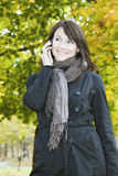 Smiling Girl on the phone Royalty Free Stock Photos