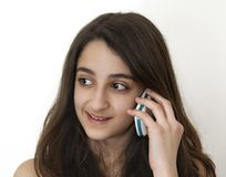 Smiling girl on the phone Royalty Free Stock Photo