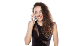 Smiling girl on the phone Stock Photography