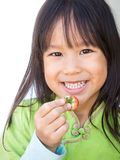 Smiling girl picking strawberry. Happy face. Portrait on white b Stock Photography
