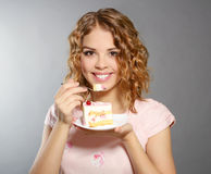 Smiling girl with piece of cake Stock Photography
