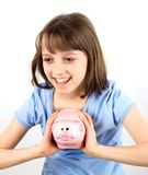 Smiling girl with piggy bank Stock Images