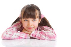 Smiling girl in pigtails Royalty Free Stock Photo