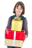 Smiling girl with pile of presents Stock Photo