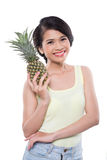 Smiling girl with pineapple Royalty Free Stock Photos