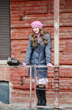 Smiling girl in pink beret posing on city street Stock Photos