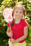 Smiling girl with a pink butterfly net Royalty Free Stock Photo