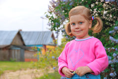 Smiling girl in pink coat Royalty Free Stock Photos