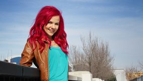 Smiling girl with pink hair stock photography