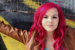 Smiling girl with pink hair Stock Images