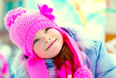 Smiling girl in a pink hat Royalty Free Stock Photography
