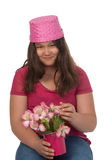 Smiling girl in pink with pink flowers Royalty Free Stock Images