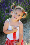Smiling girl with plaits Royalty Free Stock Photos