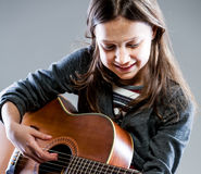 Smiling girl playing classic acoustic guitar Royalty Free Stock Image