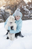 Smiling girl playing with her dog Stock Image